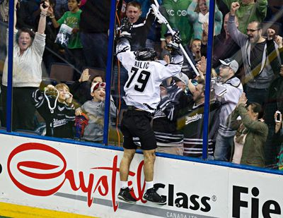 Edmonton's Nik Bilic celebrates a goal during the second half of the Edmonton Rush's NLL lacrosse playoff game against the Calgary Roughnecks at Rexall Place in Edmonton, Alta., on Friday, May 16, 2014. Codie McLachlan/Edmonton Sun/QMI Agency