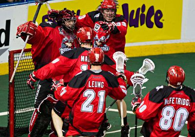 The Calgary Roughnecks celebrate their victory during the Edmonton Rush's NLL lacrosse tiebreaker playoff game against the Calgary Roughnecks at Rexall Place in Edmonton, Alta., on Friday, May 16, 2014. Codie McLachlan/Edmonton Sun/QMI Agency
