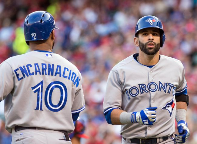 Toronto Blue Jays first baseman Edwin Encarnacion (10) congratulates right fielder Jose Bautista (19) after Bautista hits a home run during the first inning against the Texas Rangers at Globe Life Park in Arlington. (Jerome Miron-USA TODAY Sports)