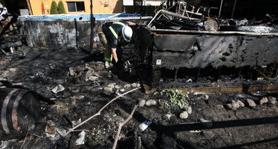 Larry and Marlene Putinski's log dream home along the Jock River in Richmond was destroyed by fire early Sunday morning, causing nearly $500,000 damage to the building and their award-winning backyard garden, hot tub, gazebos and swimming pool. DOUG HEMPSTEAD/Ottawa Sun