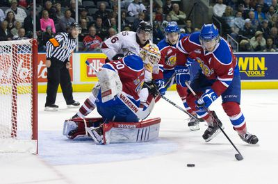 Edmonton Oil Kings defenceman Cody Corbett, right, looks to clear the puck after Oil Kings goaltender Tristan Jarry saved a shot by Guelph Storm forward Kerby Rychel during their 2014 Memorial Cup round robin hockey game at Budweiser Gardens in London, Ontario on Saturday May 17, 2014. CRAIG GLOVER The London Free Press / QMI AGENCY