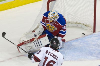 Guelph Storm forward Kerby Rychel puts the puck past Edmonton Oil Kings goaltender Tristan Jarry to score a goal during their 2014 Memorial Cup round robin hockey game at Budweiser Gardens in London, Ontario on Saturday May 17, 2014. CRAIG GLOVER The London Free Press / QMI AGENCY