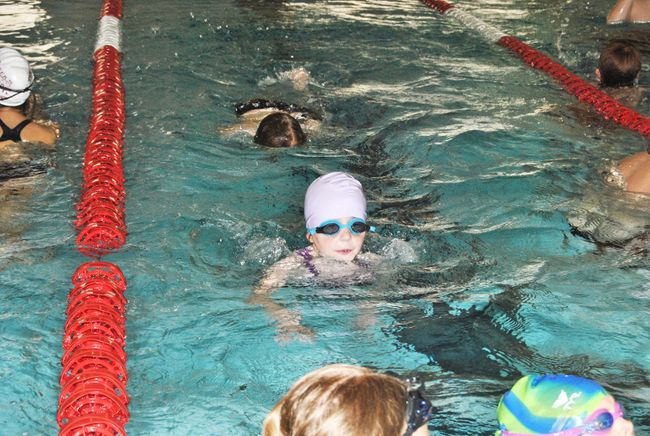 Alexa Rodminski, 9, swims towards the wall during a drill at the Blue Dolphins practice on Wednesday, May 14. Rodmininki is one of the swimmers who joined the club after taking part in Rookie Week.