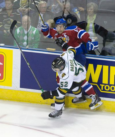 Edmonton Oil Kings forward Riley Kieser gets checked into the boards by London Knights defenceman Alex Basso during their 2014 Memorial Cup round robin hockey game at Budweiser Gardens in London, Ontario on Sunday May 18, 2014. CRAIG GLOVER The London Free Press / QMI AGENCY