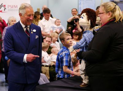 Britain's Prince Charles greets a puppet at the Military Family Resource Centre in Halifax, Nova Scotia, May 19, 2014.  The puppet is part of a centre program to promote healthy eating for children.  The royal couple are on a four-day visit to Canada that begins in Halifax and includes stops in Pictou, Nova Scotia, the Prince Edward Island towns of Charlottetown, Bonshaw and Cornwall and concludes in Winnipeg. (REUTERS/Mark Blinch)