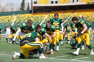 Team North celebrates after winning 14-10  over the South at the Senior Bowl, at the Commonwealth Stadium in Edmonton, Alberta on May 19th, 2014.  Chad Steeves/Edmonton Sun/ QMI Agency