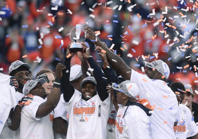 Broncos players hold up the Lamar Hunt Trophy after they defeated the Patriots in the AFC Championship in Denver on Jan. 19, 2014. (Mark Leffingwell/Reuters/Files)