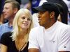 Tiger Woods and Elin Nordegren watch Game 4 of the NBA Finals in Orlando in this June 11, 2009, file photo. (REUTERS/Hans Deryk/Files)