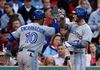 Toronto Blue Jays first baseman Edwin Encarnacion (10) celebrates his home run against the Boston Red Sox with third baseman Brett Lawrie during the second inning Wednesday at Fenway Park. (Mark L. Baer/USA TODAY Sports)