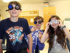 Paris Central School Grade 7 students (from left) Trent Prime, Elston Hutchison and Jade Graham try out various goggles and glasses that simulate different types of vision loss during a presentation by CNIB's Lauralynn Gentles on Wednesday, May 14. May is Vision Health Month. (MICHAEL PEELING/QMI AGENCY)