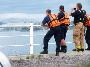 Sarnia firefighters continued to search the St. Clair River near Ferry Dock Hill following reports that someone jumped from the Canadian side of the Blue Water Bridge. BRENT BOLES/THE OBSERVER/QMI AGENCY