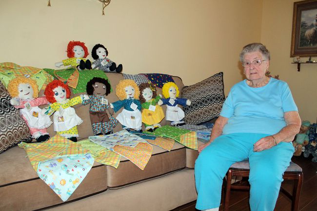Marjorie Brown poses with the dolls she and some friends made in April to give to sick and underprivileged children. (MICHAEL PEELING/QMI AGENCY)