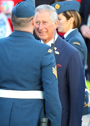 Prince Charles inspects the honour guard after he and Camilla, Duchess of Cornwall, met with the public on the Manitoba Legislative grounds on May 21, 2014, before wrapping their four-day visit to Canada. (Kevin King/QMI Agency)