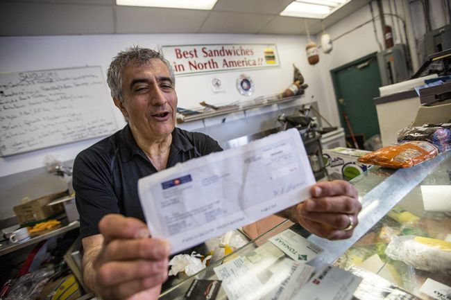 Business owner Salam Kahil at his shop in Surrey, B.C. on Wednesday May 21, 2014. A man who mailed $290 in cash to Montreal for a painting purchase says Canada Post thought it lost the money and handed him a cheque to cover their mistake — even though the cash was delivered.  (CARMINE MARINELLI/ 24 HOURS)