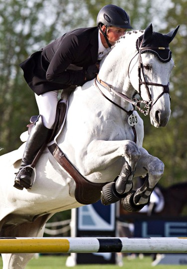 Sergey Zayika jumps Cempinsky during the ATCO Cup during the Edmonton Classic Horse Show at the Whitemud Equine Learning Centre Association in Edmonton, Alta., on Thursday, May 22, 2014. Codie McLachlan/Edmonton Sun/QMI Agency