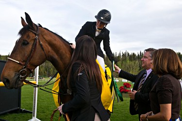 Ellicia Edgar and her horse, Cippolini Van De Gasthoeve, receive their first place medal during the ATCO Cup during the Edmonton Classic Horse Show at the Whitemud Equine Learning Centre Association in Edmonton, Alta., on Thursday, May 22, 2014. Codie McLachlan/Edmonton Sun/QMI Agency