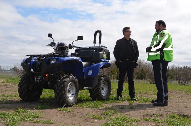 ACICR director Don Voaklander (centre) discussed OHV safety with community patrol officer Mark Elwood (right) on May 16. ACICR estimates Alberta has around 14 OHV-related deaths each year. April Hudson, Reporter/Examiner