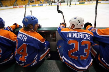 Ryan Symth and Matt Hendricks watch the Heroes Hockey Challenge between the Oilers Alumni and the PPCLI at Clare Drake Arena in Edmonton, Alberta on  Saturday, May 24, 2014.  PPCLI Foundation is partner with the Edmonton Garrison Military Family Resource Centre (MFRC) for the May 23-24, 2014 Heroes Hockey Challenge. The partnership is based on a full sharing of the net proceeds (50% to Edmonton Garrison MFRC and 50% to the PPCLI Foundation).Perry Mah/ Edmonton Sun/ QMI Agency