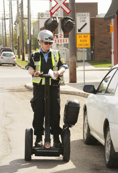 A parking patrol member uses a Segway to patrol the streets for parking offences near 105 St., and 106 Ave., in Edmonton, Alberta on Tuesday, May 20, 2014. Perry Mah/ Edmonton Sun/ QMI Agency