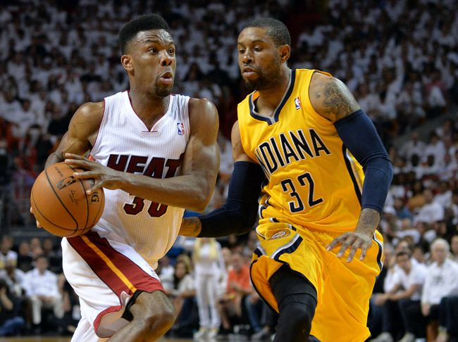 Miami Heat guard Norris Cole (30) drives to the basket against Indiana Pacers guard C.J. Watson in gGame 3 of the Eastern Conference Finals Saturday at American Airlines Arena. (Steve Mitchell/USA TODAY Sports)
