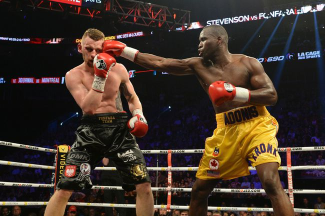 Adonis Stevenson (right) connects to the head of Andrzej Fonfara during their light-heavyweight championship bout Saturday at the Bell Centre in Montreal. (SEBASTIEN ST. JEAN/QMI Agency)