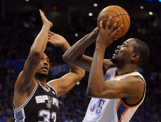 Oklahoma City Thunder's Kevin Durant (right) shoots against San Antonio Spurs defender Boris Diaw during Game 3 of the Western Conference Finals Sunday at Chesapeake Energy Arena. (Mark D. Smith/USA TODAY Sports