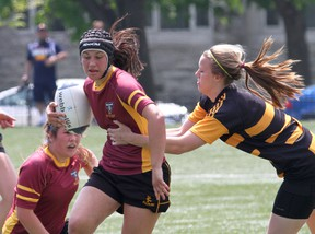 Regiopolis-Notre Dame Panthers' Hannah Greenwood tries to elude a La Salle Black Knights tackler during the Kingston Area girls rugby championship game at Nixon Field on May 22. La Salle and Regi are both head to Ontario championships. (IAN MACALPINE/THE WHIG-STANDARD)