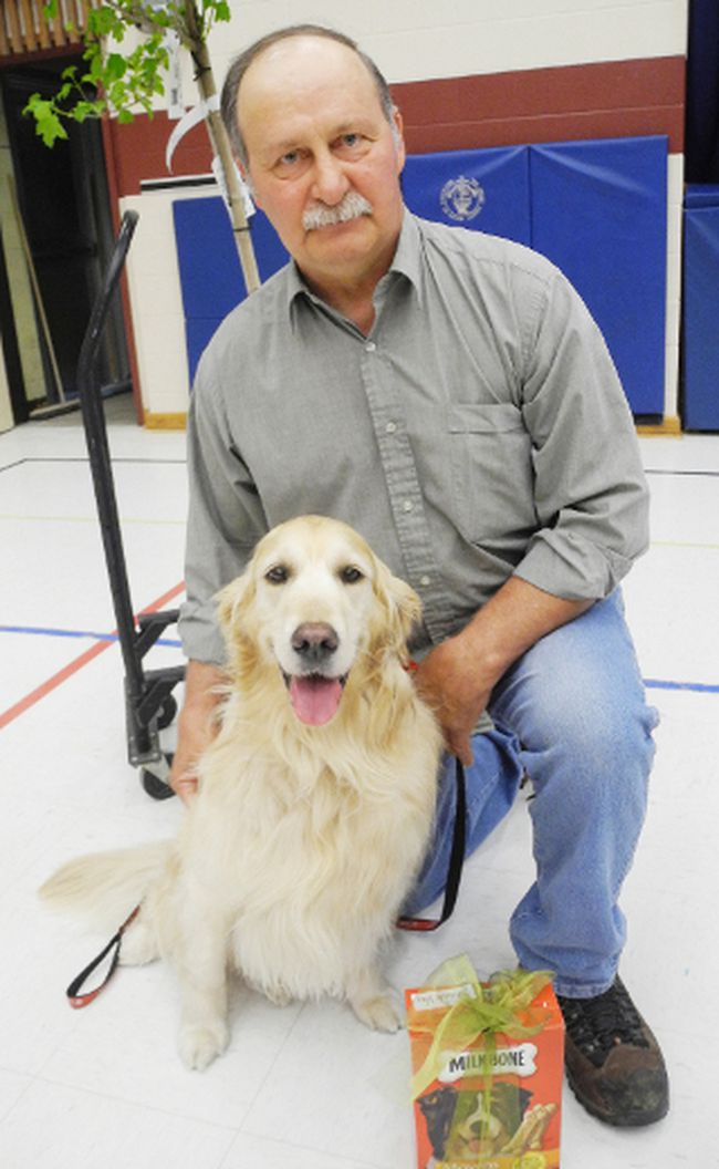 Golden retriever Amy and her owner, Dave Nakonechny, celebrated Amy's 1,000 visit as a St. John's Therapy Dog at Delhi Public School on May 21. Amy's handler and Nakonechy's late wife Pat was also honoured in the special assembly. (SARAH DOKTOR Simcoe Reformer)