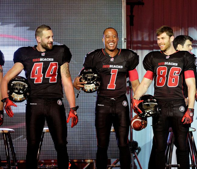 (L-R) Ottawa Redblacks #44 Justin Phillips, #1 Henry Burris and #86 Simon Le Marquand helped unveil their home uniforms in Ottawa on Tuesday, May 6, 2014. (Matthew Usherwood/ Ottawa Sun)
