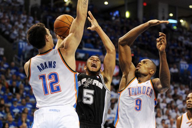 San Antonio Spurs guard Cory Joseph (5) attempts to shoot between Oklahoma City Thunder forward Serge Ibaka (9) and centre Steven Adams during NBA playoff action at Chesapeake Energy Arena Tuesday. (Mark D. Smith/USA TODAY Sports)