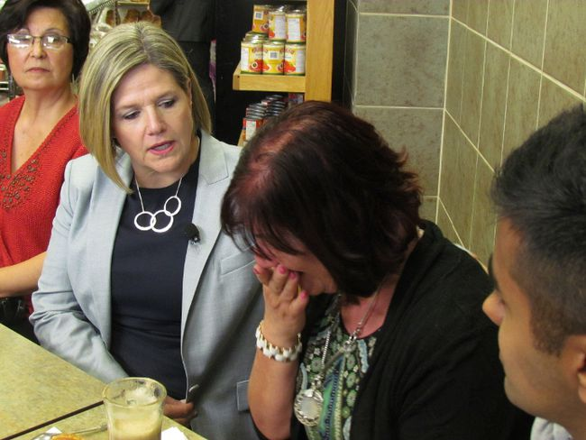 Ontario NDP Leader Andrea Horwath comforts Rosanna Balducci who describes the struggles of raising a grown child with Down Syndrome during a campaign stop in North York on  May 28 2014. (ANTONELLA ARTUSO, Toronto Sun)