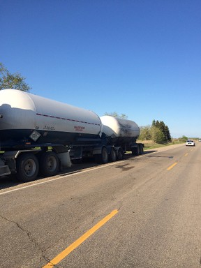 A semi-trailer pulled off the highway Tuesday, May 27, after its load caught ablaze. It was carrying anhydrous ammonia, a farm fertilizer that's not only quite flammable but also toxic. (HANDOUT)