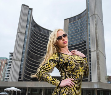 Porn star Nikki Benz poses for a photo in front of Toronto City Hall on Wednesday May 28, 2014. (Ernest Doroszuk/Toronto Sun)