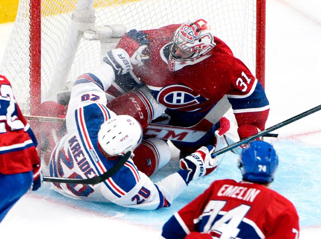The Rangers' Chris Kreider slams into Habs goalie Carey Price in the Eastern Conference final. (USA Today Sports)