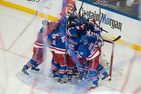 The New York Rangers celebrate after beating the Montreal Canadiens to earn a trip to the Stanley Cup. (QMI Agency)