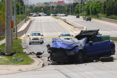Witnesses say five young men managed to exit a mangled Ford Mustang after it smashed into a hydro pole on Eglinton Ave. W., just east of Mississauga Rd. in Streetsville, on Friday. CHRIS DOUCETTE/TORONTO SUN
