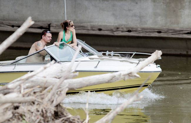 This unidentified pair slowly move past some debris in the section of the Thames River in downtown Chatham. (Diana Martin, The Daily News)