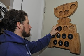 Toronto Marlies defenceman Andrew MacWilliam mounts puck No. 9 (one for each playoff win) on to a plaque following Thursday's victory over the Texas Stars. (Brad White/photo)