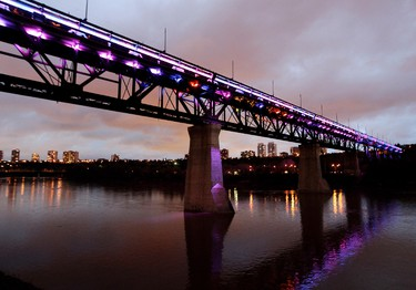 Colorful lights temporarily light up the High Level Bridge, in Edmonton Alta., on Monday May 26, 2014. The Light the Bridge project is expected to be completed July 1, 2014. David Bloom/Edmonton Sun/QMI Agency