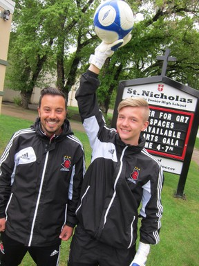 Happier times ahead for BC-bound goaltending star Dory Elliot, pictured here with coach Marco Bossio (left). (SUPPLIED)