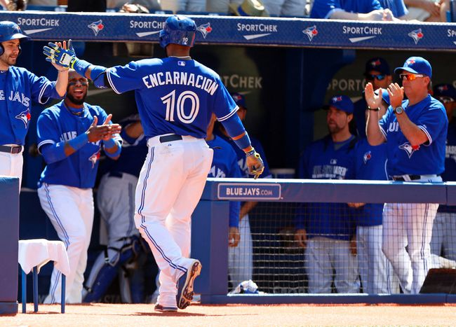 Edwin Encarnacion hits a two run homer in the eighth inning as Toronto Blue Jays defeated the Kansas City Royals 4-0 in an AL game in Toronto, Ont. on Sunday June 1, 2014. Michael Peake/Toronto Sun/QMI Agency
