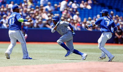 KC's Alcides Escobar is tagged out in a rundown between second and third base by Jose Reyes as Toronto Blue Jays host the Kansas City Royals in an AL game in Toronto, Ont. on Sunday June 1, 2014. Michael Peake/Toronto Sun/QMI Agency