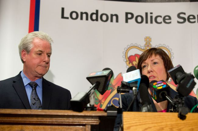 London police inspector Kevin Heslop and Children's Aid Society executive director Jane Fitzgerald speak about the rescue of a 10-year-old boy held captive for 18-24 months in London, Ont. on Friday May 30, 2014.DEREK RUTTAN/ The London Free Press /QMI AGENCY