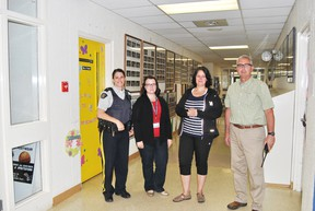 From left: RCMP Cpl. Kristen Dowsett, St. Mary Principal Ashley Floyd, Whitecourt Crime Prevention Co-ordinator Tina Prodaniuk and RCMP Const. Rob Dunbar observed a practice lockdown at St. Mary School on Wednesday, May 28. Barry Kerton | Whitecourt Star