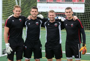 After announcing his resignation from Ottawa Fury FC Tuesday, goalkeeper coach David Bellemare (second from right) poses for a photo with the squad's goalies Marcel DeBellis, Devala Gorrick and Chad Bush. (Chris Hofley/Ottawa Sun)