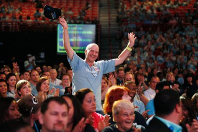 Jack Smith, Walmart private fleet truck driver, stands up to be honored at the Walmart U.S. associates meeting in Fayetteville, Arkansas June 4, 2014. The meeting was part of Walmart's annual shareholder meeting. (REUTERS/Rick Wilking)