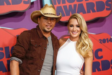 Musician Jason Aldean and girlfriend Brittany Kerr arrive at the 2014 CMT Music Awards in Nashville, Tennessee June 4, 2014. REUTERS/Eric Henderson
