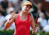 Eugenie Bouchard of Canada reacts during her women's semi-final match against Maria Sharapova of Russia at the French Open tennis tournament at the Roland Garros stadium in Paris June 5, 2014.  (REUTERS)