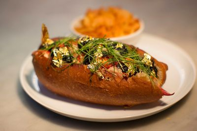 """A gold and caviar-enriched lobster roll that sells for $160 is served with a side of fresh crispy potato chips at """"BLT Fish"""" restaurant in New York June 4, 2014. BLT Fish is a high-end fish restaurant and has a less expensive dining room two floors below, called """"BLT Shack"""", which already serves a traditional lobster roll. Luke Venner, executive chef at """"BLT Fish"""" in Manhattan, said his inspiration for his caviar and gold-infused version was a desire to tie the two restaurant concepts together.   REUTERS/Brendan McDermid"""