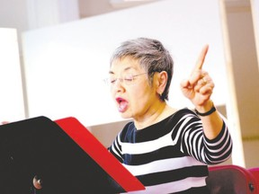 Judy Brown, retired music educator and Western Don Wright music faculty grad, directs the Cantorion Choir. (Special to QMI Agency)